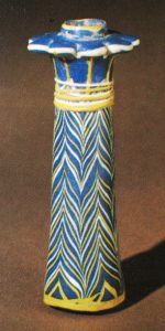 An original palm kohl-tube, c.1400-1225 BC. From Goldstein, S. (1979) 'Pre-Roman and Early Roman Glass in The Corning Museum of Glass' Corning: New York, cat. no. 24, inv. no. 71.1.4, showing lead antimonate yellow decoration